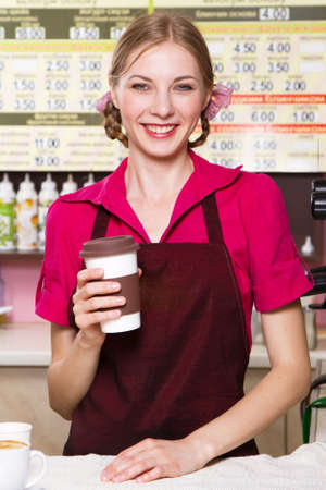 food an drink: Friendly waitress making coffee at coffee machine