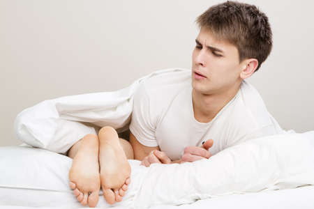 stink: Young couple in bed