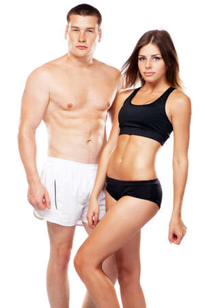 fitness couple: Beautiful healthy-looking young couple in sports outfit