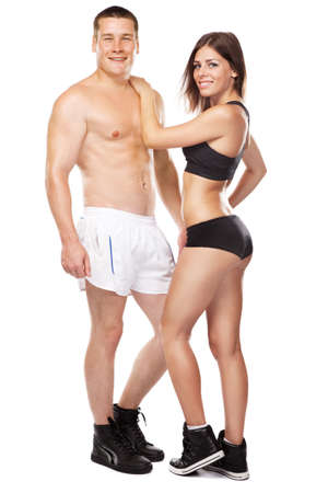 athletic body: Beautiful healthy-looking young couple in sports outfit