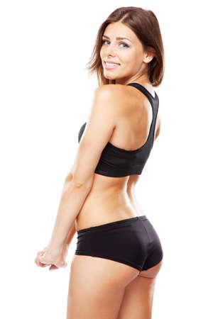 http://us.123rf.com/450wm/gdolgikh/gdolgikh1207/gdolgikh120700031/14344821-young-fit-woman-in-sports-outfit-isolated-on-white-background.jpg
