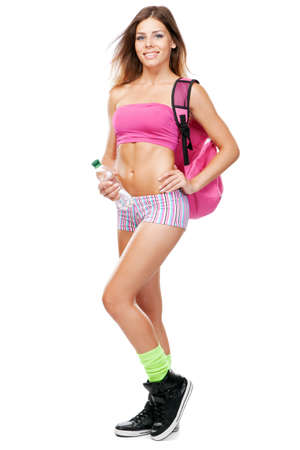 Young fit woman in sports outfit, isolated on white background photo