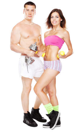 Beautiful healthy-looking young couple in sports outfit photo