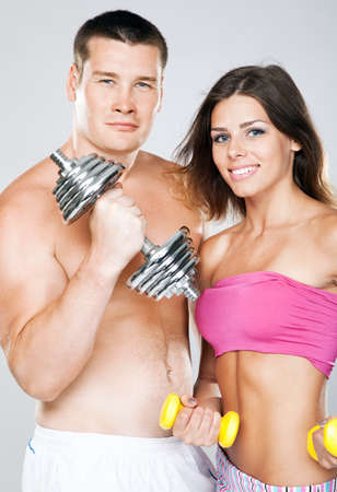 muscle women: Beautiful healthy-looking young couple in sports outfit