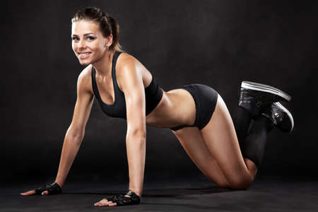 fitness model: Young fit woman in sports outfit, doing push-ups