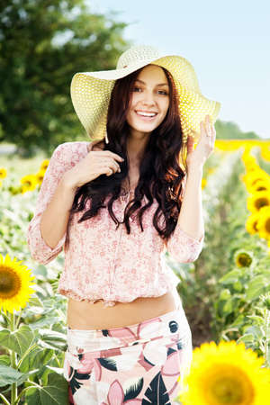 Beautiful lady walking in sunflower field photo