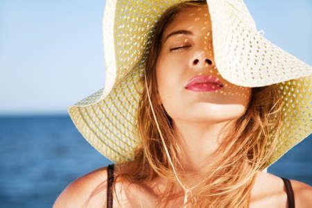 woman beach: Beautiful woman on a beach on a sunny day