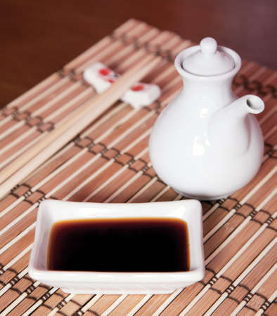 soy sauce: Soy sauce for sushi on a bamboo pad
