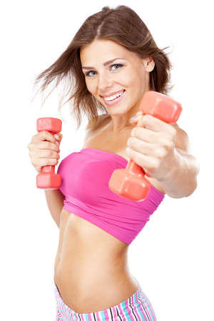 Beautiful slim woman with dumbbells, isolated on white background photo