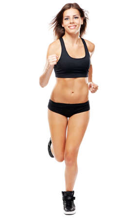 Young woman running in sports outfit, isolated on white background photo