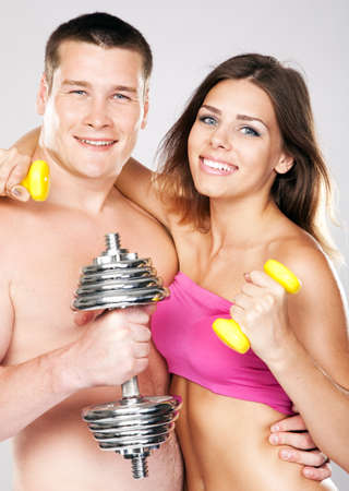 Beautiful healthy-looking young couple in sports outfit Stock Photo - 14432787