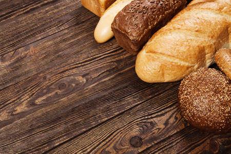 bakery shop: Bread assortment on a wooden table