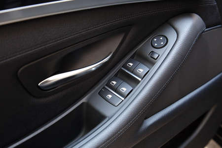 Car door handle with adjustment knobs photo