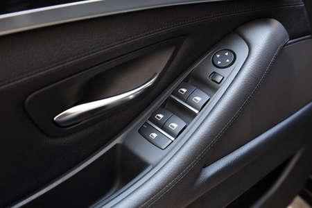 lift lock: Car door handle with adjustment knobs Stock Photo