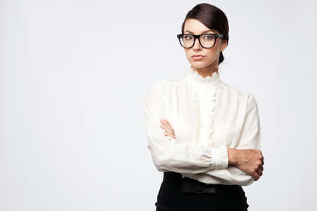 Strict woman in large glasses, isolated on white background Stock Photo - 15489668