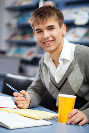 Handsome male student in a university library photo