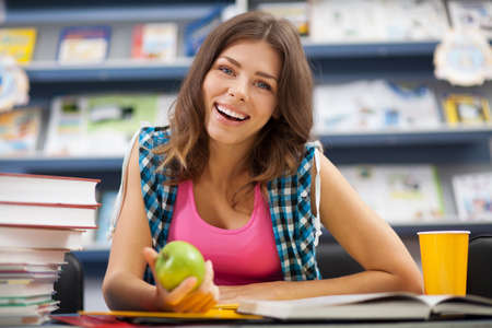 Beautiful female student in a university library Stock Photo - 16521500