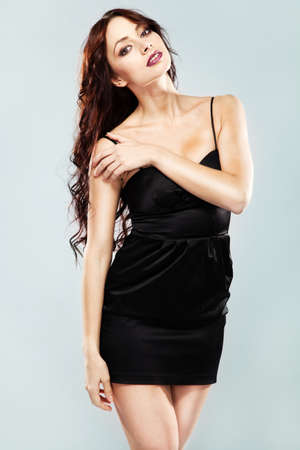 Gorgeous brunette in black dress photo