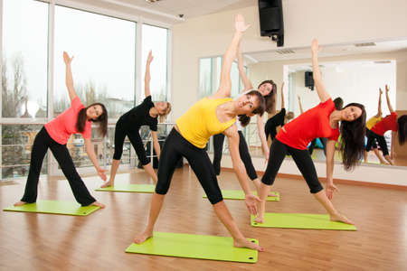 fitness club: Group training in a gym of a fitness center Stock Photo