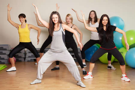 dance club: Group training in a gym of a fitness center Stock Photo