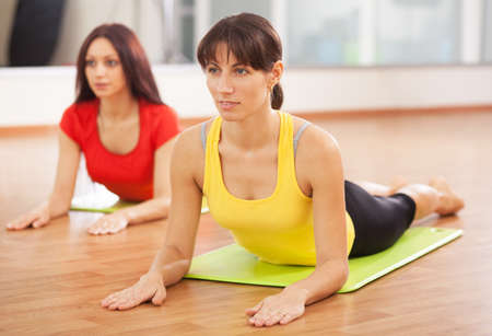health clubs: Group training in a gym of a fitness center Stock Photo