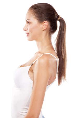 visage profil: Enthousiaste beau portrait de jeune femme le visage, fond blanc