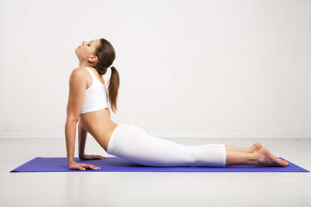 yoga girl: Woman doing stretching exercises in a gym