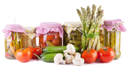 Canned and fresh vegetables isolated on white background Stock Photo