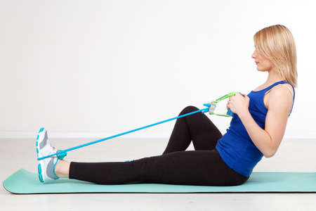 Woman exercising with a rubber band photo