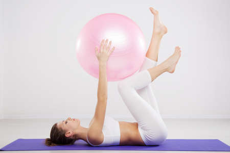 Woman on a fitness ball in a gym