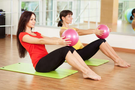 Group training in a gym of a fitness center Stock Photo - 17657655