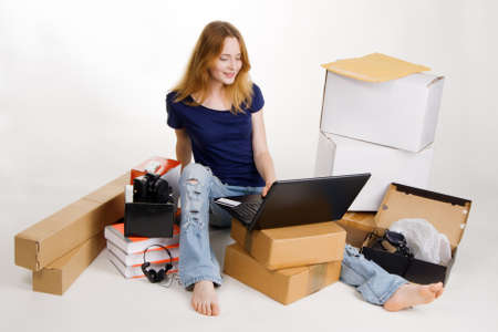 buying online: Woman buying in online stores Stock Photo