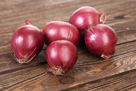 Red onion on a wooden table Stock Photo - 17879643