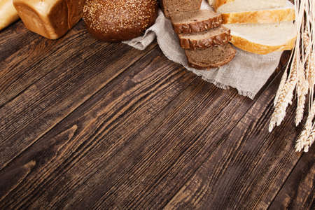 Bread assortment on a wooden table photo