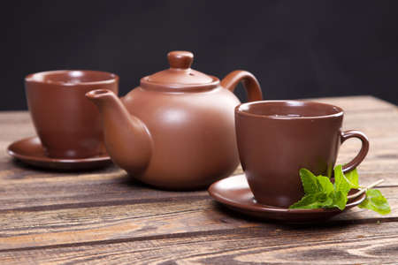 Tea with mint on a wooden table - studio still life photo