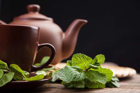 Tea with mint on a wooden table - studio still life Stock Photo - 17998448