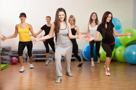 aerobics class: Group training in a gym of a fitness center Stock Photo