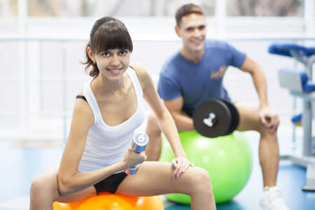 Cheerful young couple in a gym photo