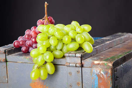 Grapes on a wooden crate photo