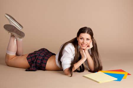 educacion sexual: Mujer en un traje de colegiala
