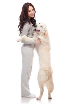 Beautiful young woman with golden retriever photo