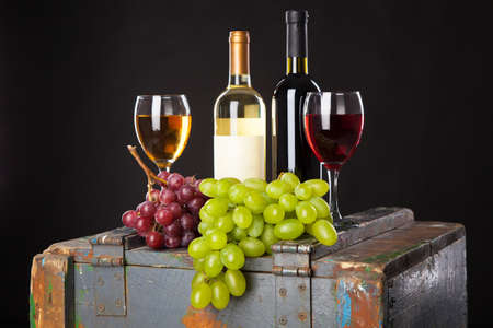 Wine and grapes on a wooden table photo