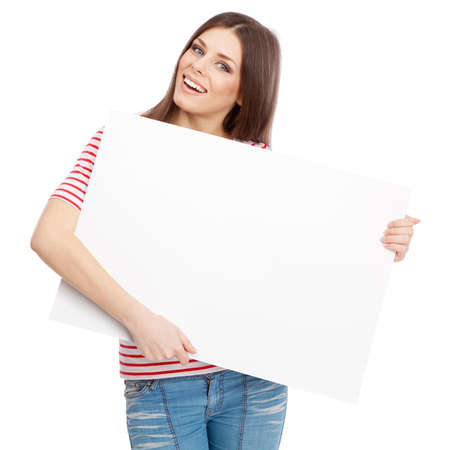 Casual young woman holding a white board photo