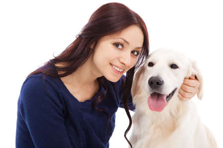 Beautiful young woman with golden retriever