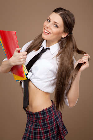 Woman in a schoolgirl costume photo