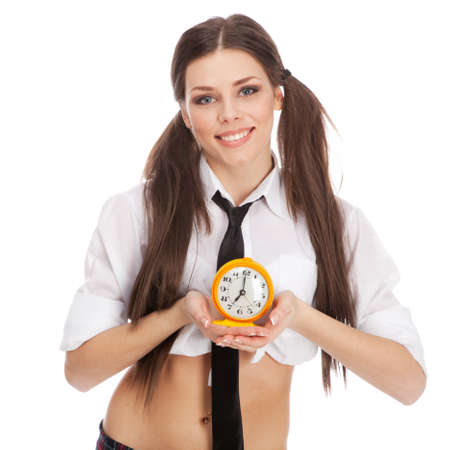 Woman in a schoolgirl costume holding an alarm clock photo