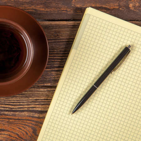 copywriting: Blank notepad on a wooden table Stock Photo