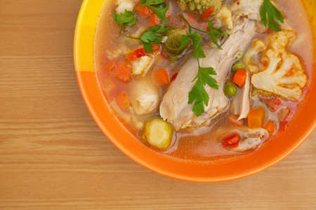 Chicken soup with vegetables photo