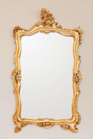 mirror: Golden mirror frame on the wall Stock Photo