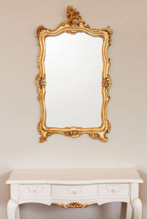 Golden mirror frame on the wall photo